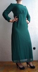 Predivna, kvalitetna haljina. Nema nikakvih ostecenja. Velicina jaci - Bor
