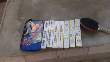 Stolüstü tennis üçün raketka və toplar satılır