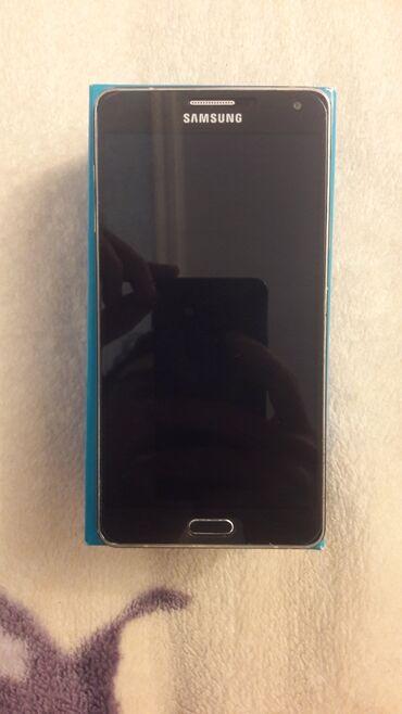 Samsung A7. Sumqayitdadi. Problemsizdi. Karopka ve adaptiriyla bir