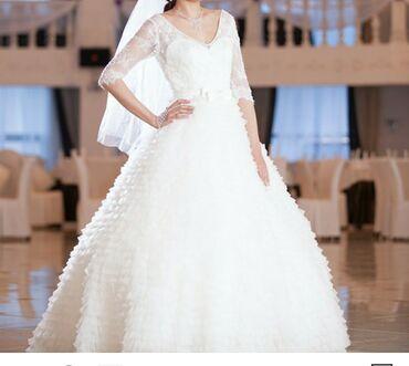 Продам свадебные платья от 00сесть б/у и новые
