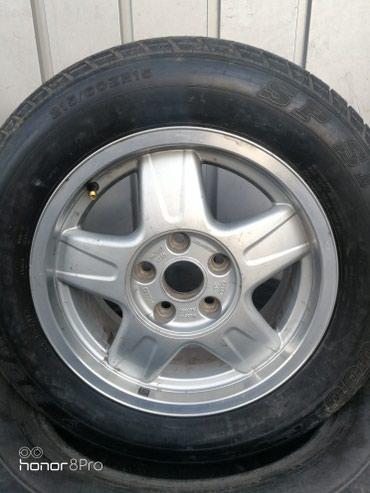 Один диск на ауди 100 или А 6 . Новая резина. На 215х60х15. в Бишкек