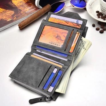 Bakı şəhərində Kiçik ölçülü qara dərili kişi cüzdanı satılır.