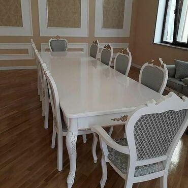 Stol desti 8 stulu 2 kreslosu ile bir yerde stolun uzunlugu 2.40 eni
