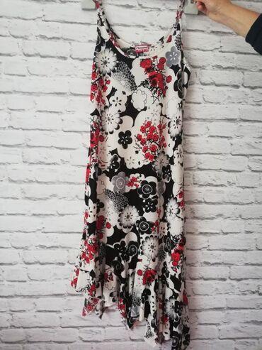 Haljine - Sremska Kamenica: Prodajem haljinu u M velicini. Duzina 98cm sa karnerima, poluobim