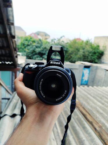 Фото и видеокамеры в Азербайджан: Nikon D3100Salam heç bir problemi yoxdu olsa pulnan çıxlacağ barter
