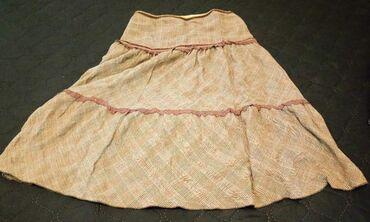 Braon suknja vel. 40. postavljena za hladnije dane