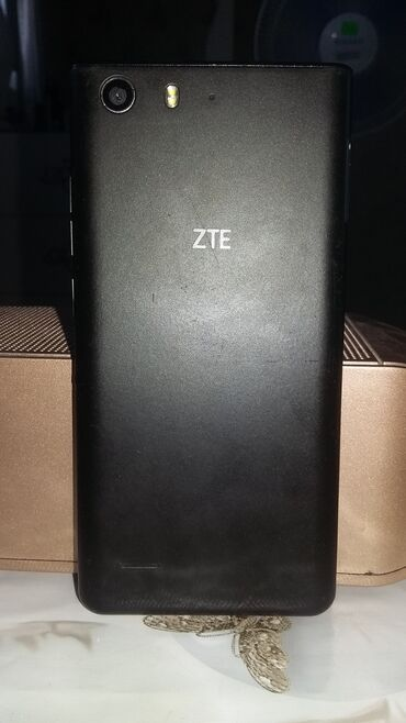 ZTE - Azərbaycan: Telefon normal veziyyetdedi,zaryadkani normal saxliyir,karopkasi yoxdu