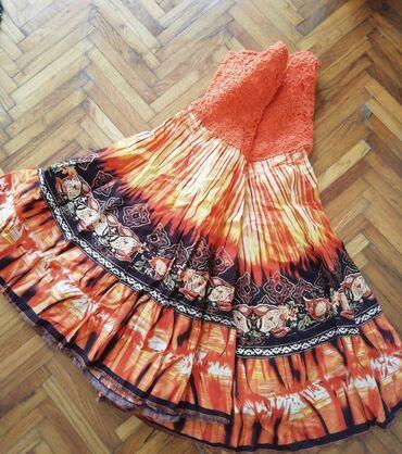 Suknja, univerzalna vel, nikad nije nosena. Dubokog struka sa