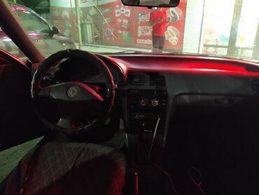 серая kia в Ак-Джол: Honda Accord 2 л. 1993 | 304304 км