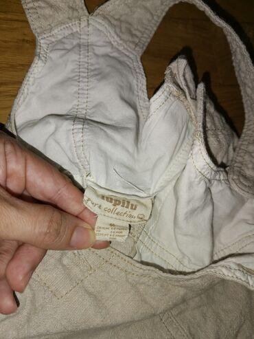 Lupilu laneno pamučne pantalone na tregere. Bež boje.Vel od 4-6 meseci