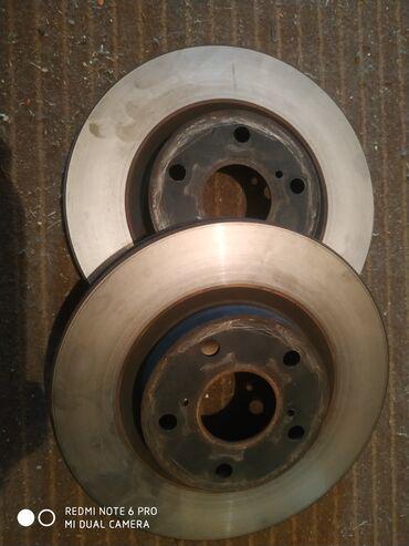 диски камри в Кыргызстан: Диски тормозные передние. камри 40, 50.состояние хорошее