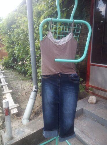 Ženska odeća | Subotica: Majica Veličina:M Cena:150 din Pantalone Veličina:42 Cena:200 din