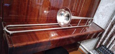 Другие музыкальные инструменты в Кыргызстан: Продается тромбон - тенор Ленинград новый, кулиса ходит плавно, строй