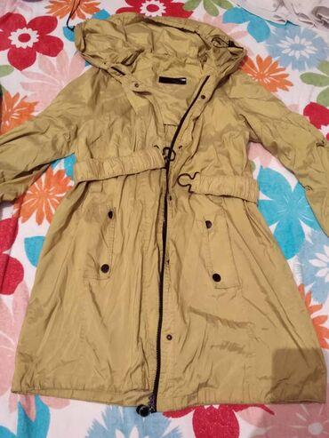 Женская одежда - Кой-Таш: Плащевка женскаяне носили ни разу. Горчичный цвет,размер 52-54.  Пал