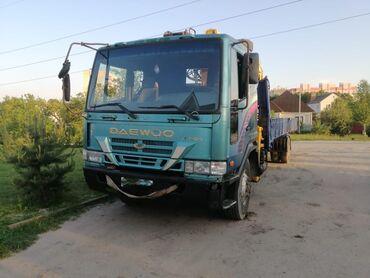 транспортные услуги крана манипулятора в Кыргызстан: | Стрела 21 м. 7500 т | Борт 12000 кг