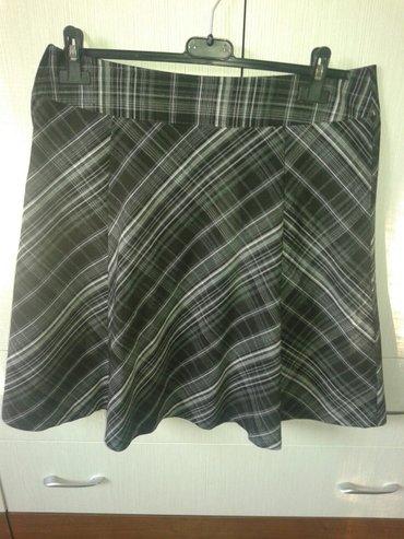 Suknja je postavljena, materijal odlican lepo pada, duzina malo iznad - Valjevo
