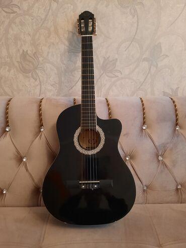 sutkalıq yaşayış yeri kirayələmək - Azərbaycan: Gitara satıram,bu gitaranın heç bir problemi yoxdur,Simləri hamısı