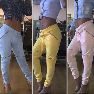 Pantalone zute sa zipzarima novo univerzalna velicina - Backa Palanka