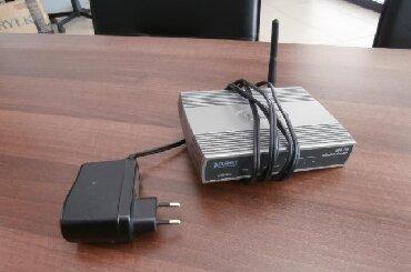 роутер тп линк 2 антенны в Кыргызстан: Продаю wifi роутер wrt-415, подключать можно к Мегалайн, Хомлайн и