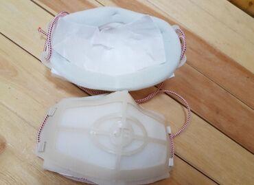 Пластиковая маска.Многослойная, можно менять сменные фильтры, защитные