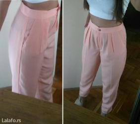 Elegantne pantalone kajsija boje sa dubokim strukom ( prelazi tek in Novi Sad