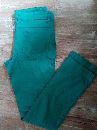 Ženske pantalone, veličina 34,marke Okay bez oštećenja uz telo