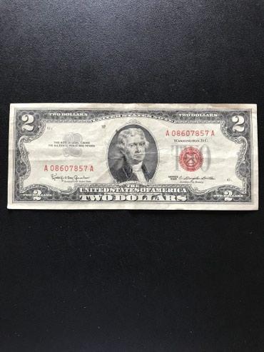 1963 cu ilin 2 dollari, qirimizi mohurle normal veziyyetde