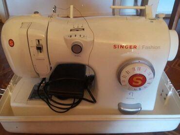 Электроника в Покровка: Швейная машинка ЗИНГЕР,много функциональная.В упаковке навая 17000 сом