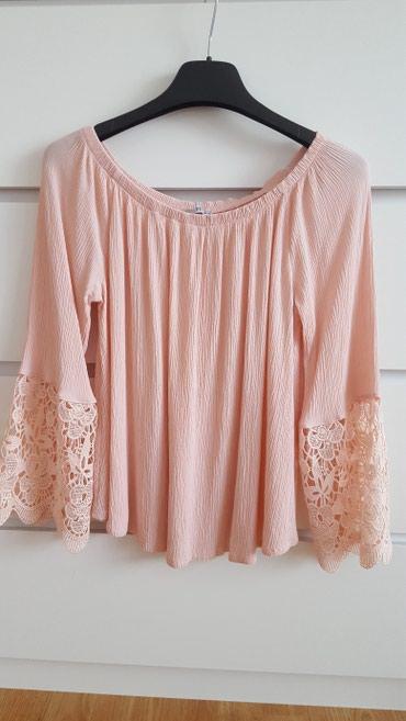 Bluza roze boje sa detaljima na rukavima. Veličina 40. Nošena - Indija