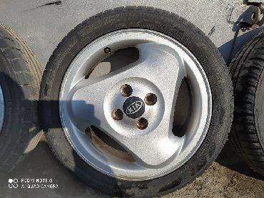 kia k в Ак-Джол: KIA :Оригинал диски с покрышками, диски не вареные в хорошем