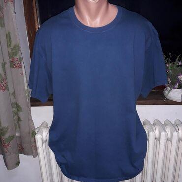 Plava majca XLSastav:pamuk 100%,Očuvana. Dimenzije:poluobim preko