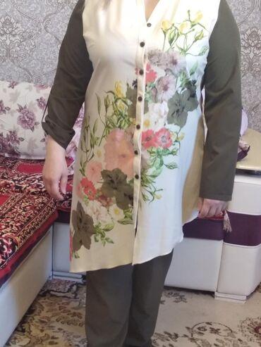 Yeni geyinilmemiw turkiyenindir kostyum etiketi üstündədir 150 AZN