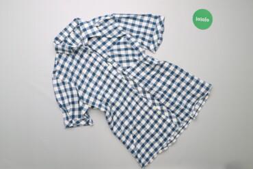 Жіноча сорочка у клітинку з коротким рукавом    Довжина: 68 см Ширина