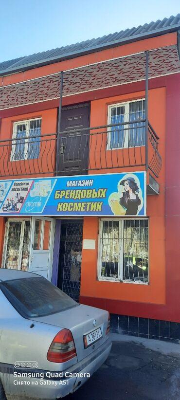 Продается двухэтажный магазин в ценре города Исфана рядом с РОВД было