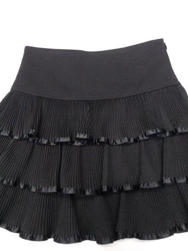 Классная, красивая юбка отлично сидит.Тканьхорошая.Фирма  на 8-9 лет