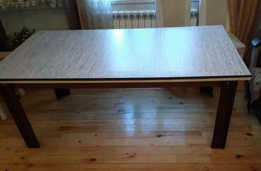 Masa 100azn satilir.olcusu 1×2mdir.eve boyuk oldugu ucun satilir unvan