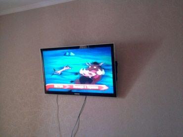 Установка люстр карнизов зеркал телевизоров на стену в Бишкек