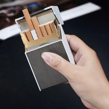 Стильный портсигар, оформленный, как пачка сигарет имеет встроенную эл