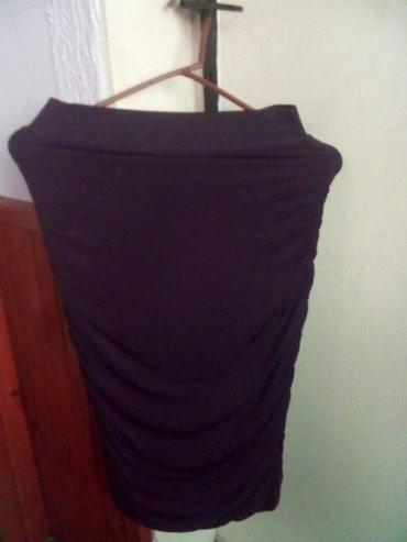 Uska suknja-haljina,svecana,sa strane naborana,prati liniju tela. - Zrenjanin