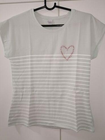 Nova majica iz Feedback-a veličine L