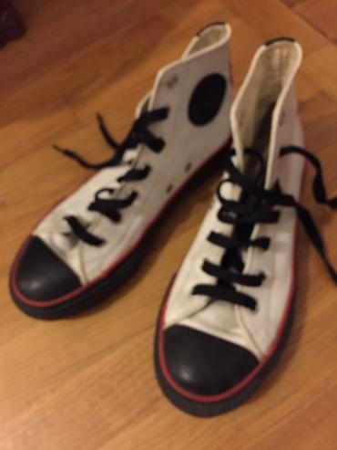 All Star Leather boots . White with black and red decoration . Worn σε North & East Suburbs