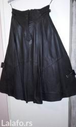 Crna kozna suknja, siroka, kupljena u italiji. Odgovara nasem broju 36 - Beograd