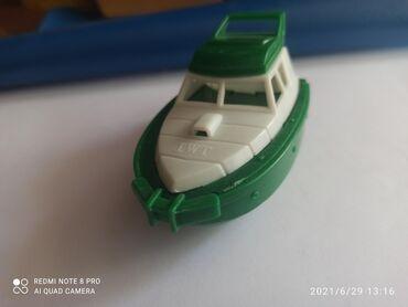 Детский мир - Орловка: Зелёный пластмассовый корабль