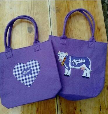 Drzaci za carape - Indija: Dve Milka torbicedobre za paketic Cena za obe