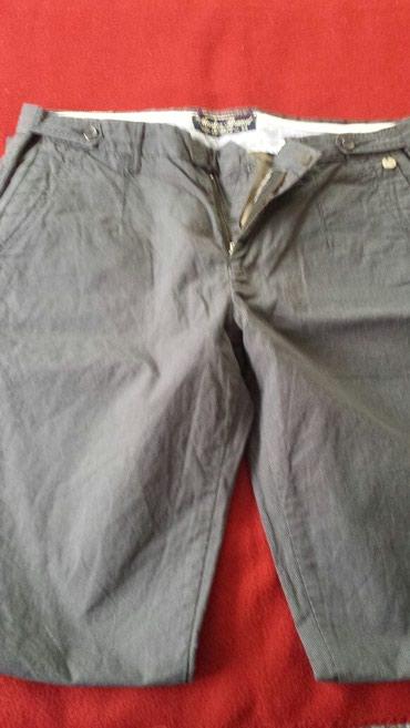 Muske teget pantalone sa prugicama vel l ili 34 - Veliko Gradiste