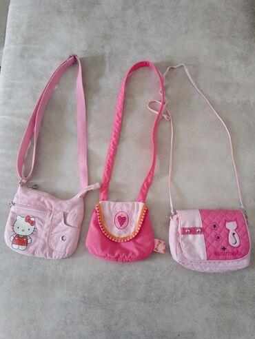Anatomski ranac - Crvenka: Tri torbice i ranac za devojcice. Rajfeslusi na rancu su ispravni samo