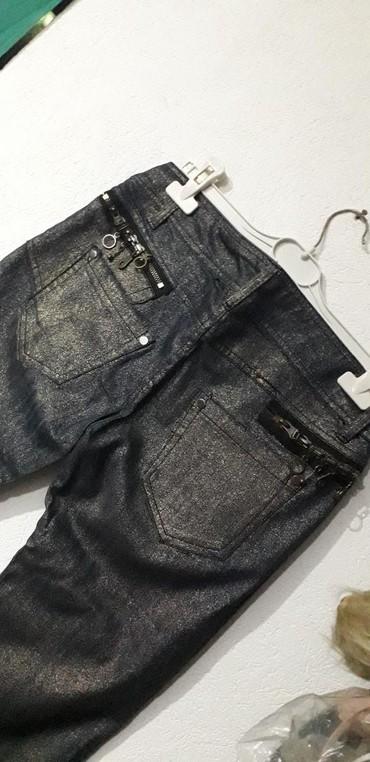 Pantalone i farmerice komad - Srbija: Nove farmerice xl prelamaju se u zkati boji . prelepo stije