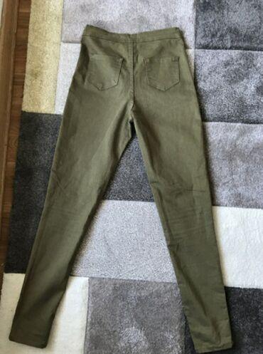 Maslinaste pantalone broj 38 kao nove odgovara i s/m velicini