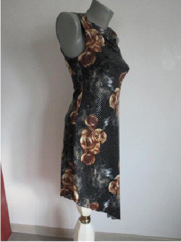 Duks haljina - Kraljevo: Haljina sa krljustima S velCrna tegljiva haljina, lepo pada i istice