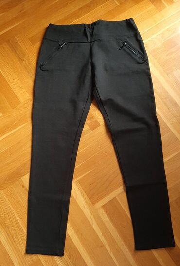 Crne pantalone/helanke univerzalne. Bez ostecenja, ocuvane. Lepo